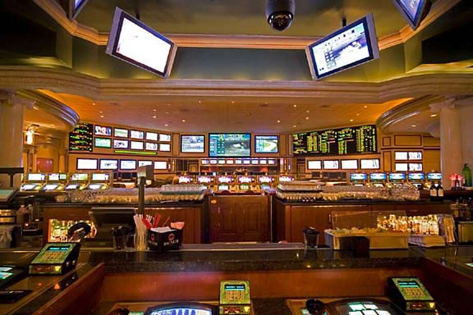 The Venetian is one of the cozier spots for sports book in Las Vegas. The casino's sports lounge features state-of-the-art big-screen monitors to watch sporting events such as the Super Bowl. Photo courtesy of Harrah's Entertainment
