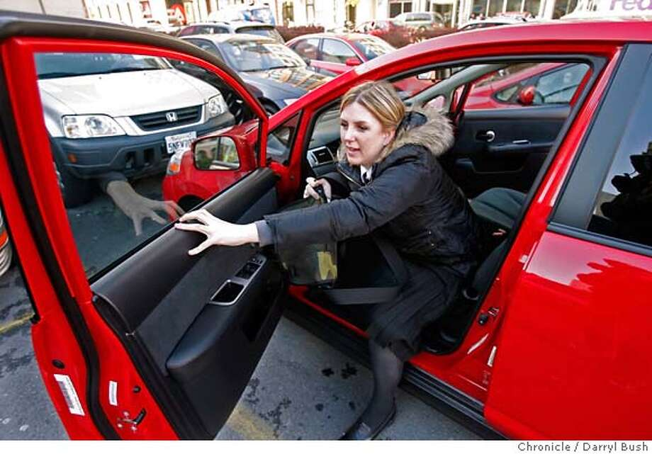 carshare_0004_db.JPG  Tara Hunt of San Francisco, gets inside a Nissan Versa, one of many Zipcars she uses from the car share service at a parking lot at 2nd and Howard Streets in San Francisco, CA, on Wednesday, January, 17, 2007. photo taken: 1/17/07  Darryl Bush / The Chronicle ** Tara Hunt (cq) MANDATORY CREDIT FOR PHOTOG AND SF CHRONICLE/ -MAGS OUT Photo: Darryl Bush