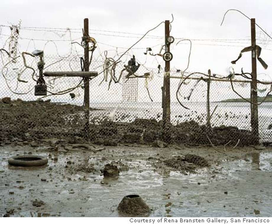 "Caption: ""Untitled (fence)""�(2003) C-print by Eirik Johnson [cq]  �  Courtesy of Rena Bransten Gallery, San Francisco"