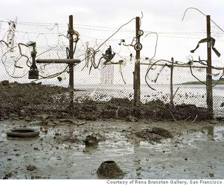 "Caption: ""Untitled (fence)""�(2003) C-print by Eirik Johnson [cq]  �  Courtesy of Rena Bransten Gallery, San Francisco"