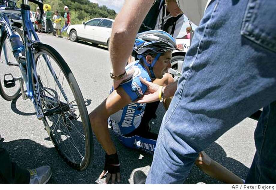 Tour de France doctors tend to Manuel Beltran of Spain, of Team Discovery Channel, after he fell during the 12th stage of the Tour de France cycling race between Briancon, French Alps, and Digne-les-Bains, southeastern France, Thursday, July 14, 2005. (AP Photo/Peter Dejong) Photo: PETER DEJONG