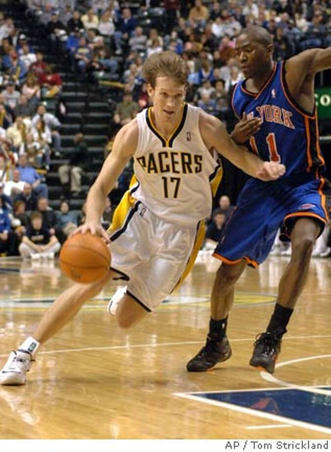 Indiana Pacers' Mike Dunleavy (17)drives on the New York Knicks' Jamal Crawford in third quarter NBA basketball action at Conseco Fieldhouse in Indianapolis on Saturday Jan. 20, 2007. New York won, 108-106. (AP Photo/Tom Strickland) Photo: Tom Strickland