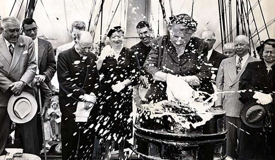 Inda Dunn makes a splash as she rechristens the 1886 square-rigger ship the Balclutha on July 19, 1955. Chronicle file photo, 1955, by Bob Campbell