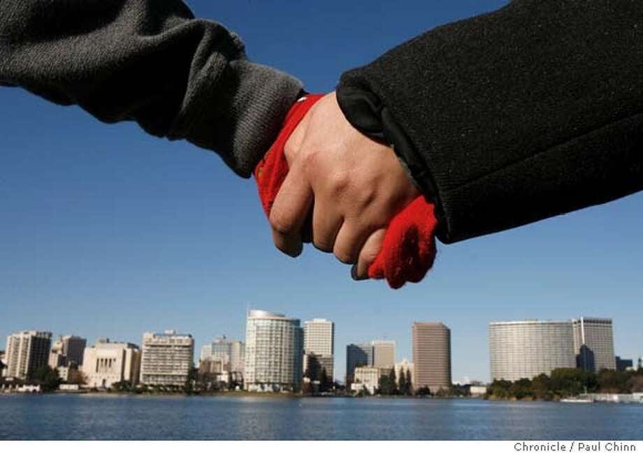 """Residents joined Oakland Mayor Ron Dellums to hold hands together around Lake Merritt during the """"Hands Around the Lake"""" event in Oakland, Calif. on Saturday, Jan. 13, 2007. It was one of a number of public events held to celebrate Dellums' inaugural week.  PAUL CHINN/The Chronicle Photo: PAUL CHINN"""