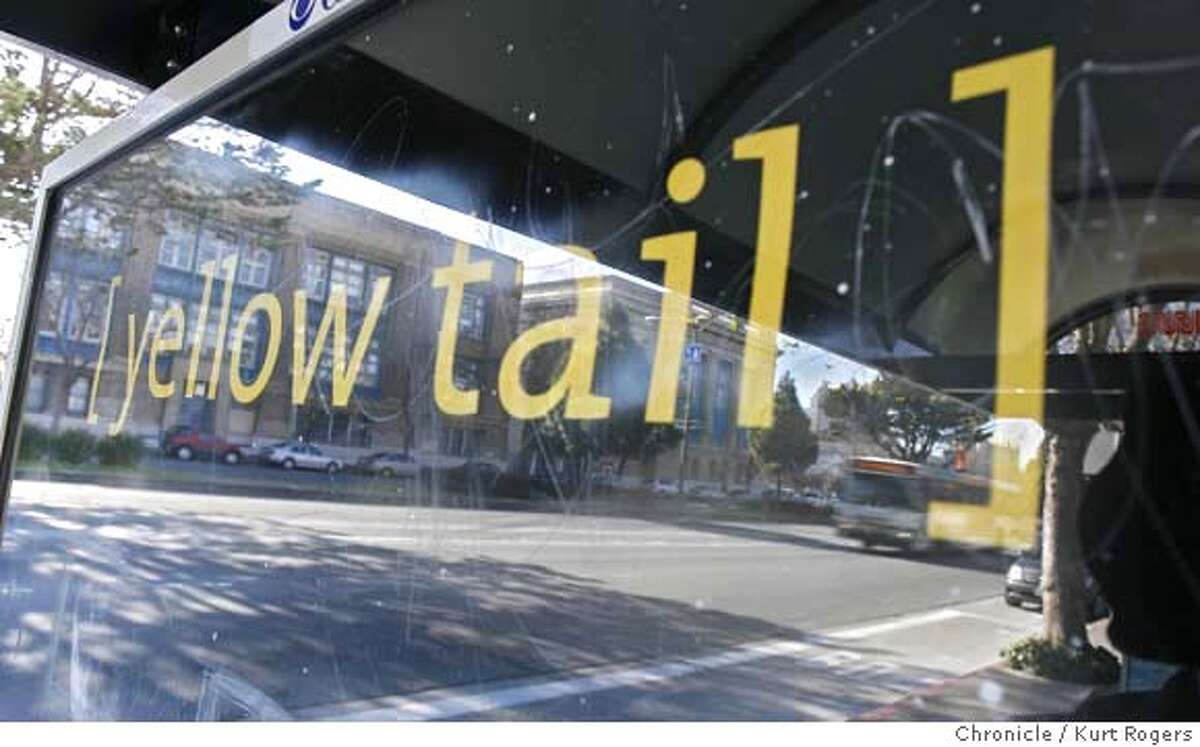 Gateway high school reflects in a Yellow tail ad on a bus shelter on Gary st in San Francisco . An anti-alcohol advocacy group is miffed because ads are showing illegally appearing on bus shelters. The signs can not be within 500 feet of a school. This Yellow Tail sign is on the west bound side of Gary St across from Gateway High School. Wednesday, JANUARY 17, 2007 KURT ROGERS/THE CHRONICLE SAN FRANCISCO THE CHRONICLE SFC MUNIADS18_0040_kr.jpg MANDATORY CREDIT FOR PHOTOG AND SF CHRONICLE / -MAGS OUT