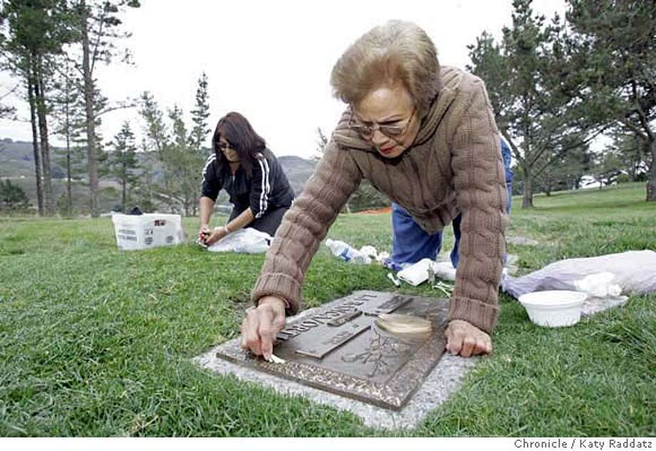100106_DONATOXX_RAD_005_RAD.jpg  SHOWN: Virginia Ortiz, Donato's grandmother (foreground, on R) and Margie Ortiz, Donato's mother (L) tend to Donato's grave at the Skylawn Cemetary in San Bruno. Story is about Donato La Banca, who was murdered four years ago, and whose killers were never caught, and how Donato's death continues to haunt his mother, grandmother, and two aunts, all who raised him. These pictures were made on Sunday, Oct. 1, 2006, in San Bruno, CA. (Katy Raddatz/The S.F.Chronicle)  **Donato La Banca, Margie Ortiz, Virginia Ortiz Mandatory credit for photographer and the San Francisco Chronicle/ -Mags out Photo: Katy Raddatz