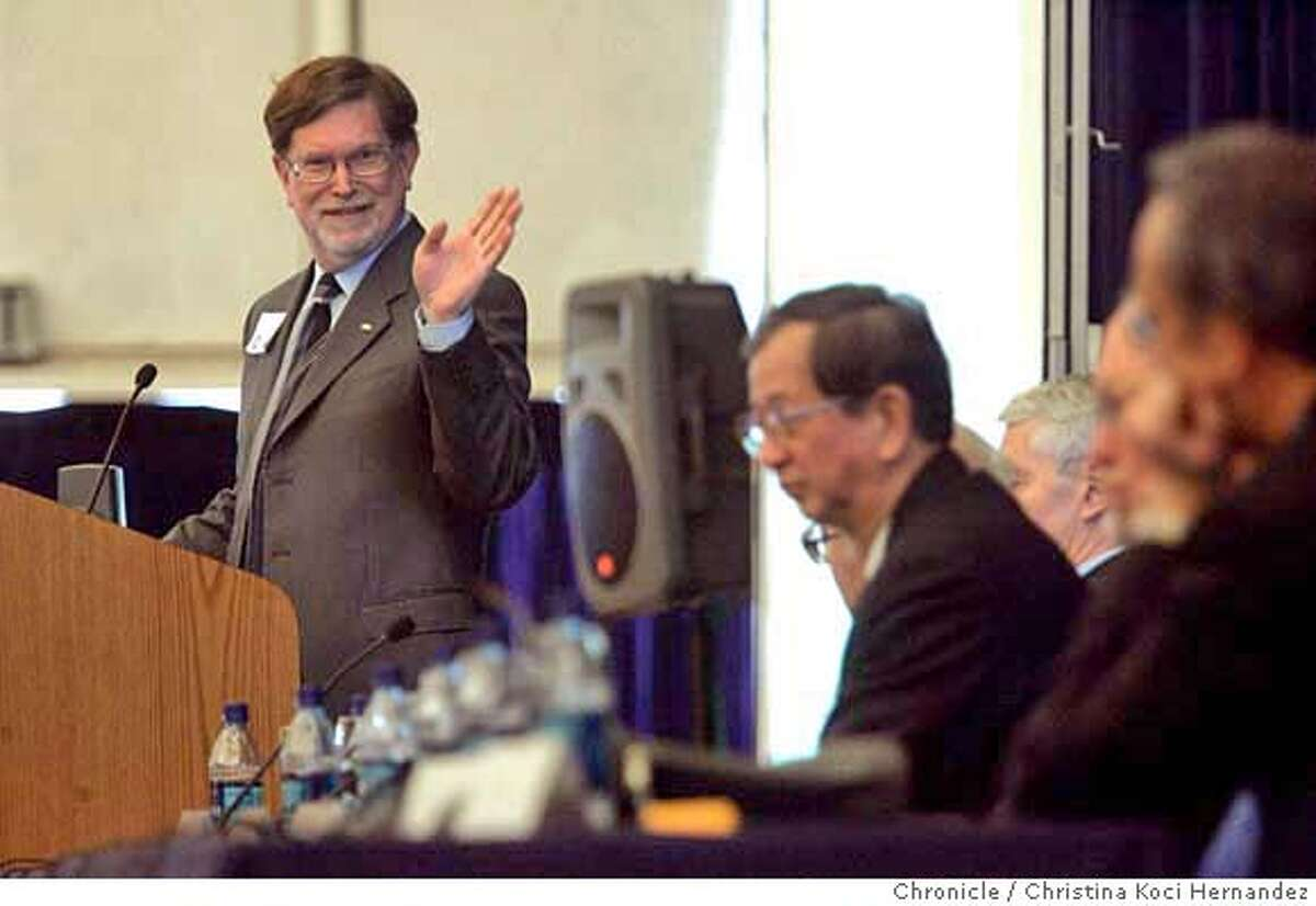 GEORGE F. SMOOT, a UC Berkeley physics professor and winner of the 2006 Nobel Prize in physics, speaks to the crowd. On right, head coming out, is YUAN T. LEE, a UC Berkeley chemistry professor emeritus and winner of the 1986 Nobel Prize in chemistry. Six Nobel laureates gather at Cal with Chancellor Robert Birgeneau to discuss energy self-sufficiency in the 21st century. The Nobelists are: STEVEN CHU, director of Lawrence Berkeley National Laboratory and the 1997 winner of the Nobel Prize in physics; DONALS GLASER, a UC Berkeley physics professor emeritus and winner of the 1960 Nobel Prize in physics ; YUAN T. LEE, a UC Berkeley chemistry professor emeritus and winner of the 1986 Nobel Prize in chemistry; DANIEL McFADDEN, a UC Berkeley economics professor who won the 2000 Nobel Prize in economics; GEORGE F. SMOOT, a UC Berkeley physics professor and winner of the 2006 Nobel Prize in physics; CHARLES TOWNES, a UC Berkeley emeritus professor of physics and winner of the 1964 Nobel Prize in physics. (CHRISTINA KOCI HERNANDEZ/CHRONICLE) CHRONICLE Photos by CHRISTINA KOCI HERNANDEZ