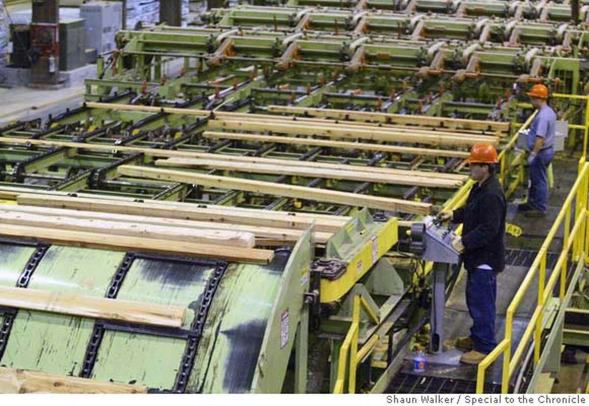 Equipment operators monitor and adjust as rough-hewn lumber moves along an edger in the Scotia Mill on June 1. Photo by Shaun Walker/For The Chronicle Ran on: 06-12-2005 Ran on: 06-12-2005 Ran on: 06-12-2005 Workers monitor rough-hewn lumber and make adjustments as it moves along an edger at PALCOs new mill in Scotia. Ran on: 06-12-2005 Workers monitor rough-hewn lumber and make adjustments as it moves along an edger at PALCOs new mill in Scotia.