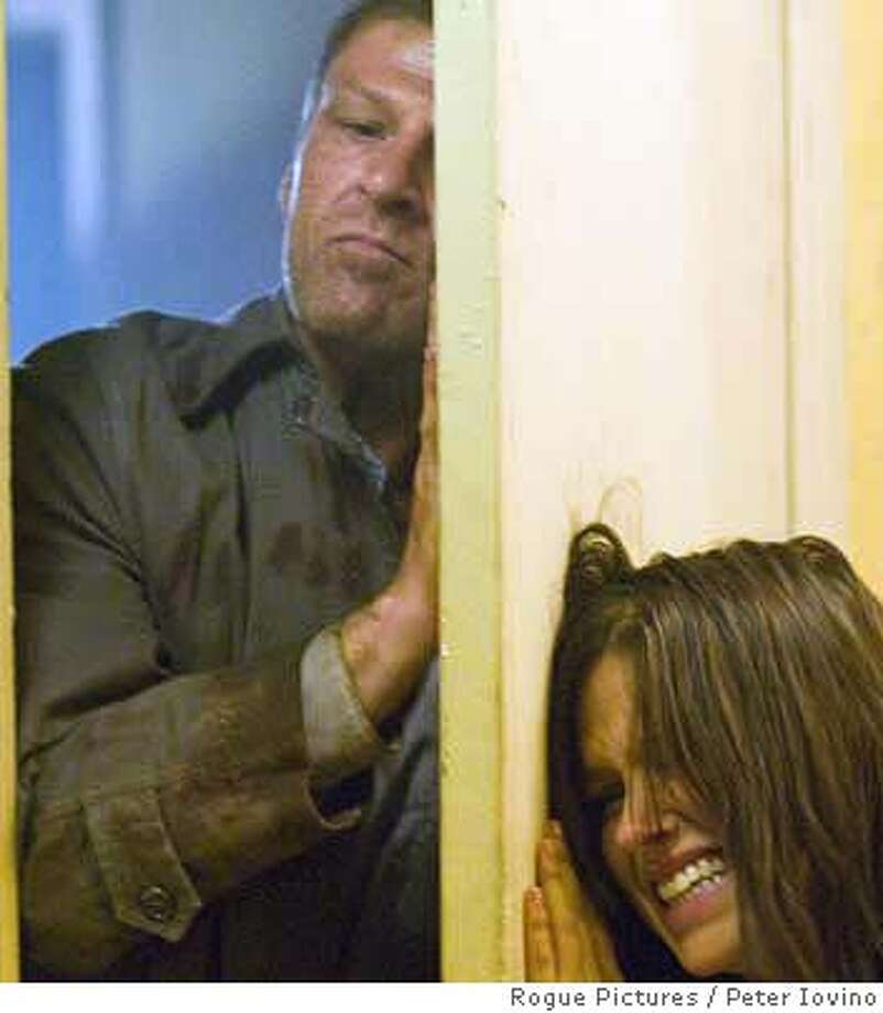 "Grace Andrews (Sophia Bush) attempts to thwart John Ryder (Sean Bean), the hitchhiker gone bad, in Dave Meyer's thriller, ""The Hitcher,"" opening Friday. Credit: Peter Iovino/Rogue Pictures  Ran on: 01-14-2007  Two teenage girls use clothespins to keep their eyes open and avoid fines for falling asleep in &quo;China Blue,&quo; a documentary shot by Micha Peled inside a jean factory. The film opens Friday at the Roxie in San Francisco and the Smith Rafael Film Center in San Rafael. Photo: Peter Iovino/Rogue Pictures"