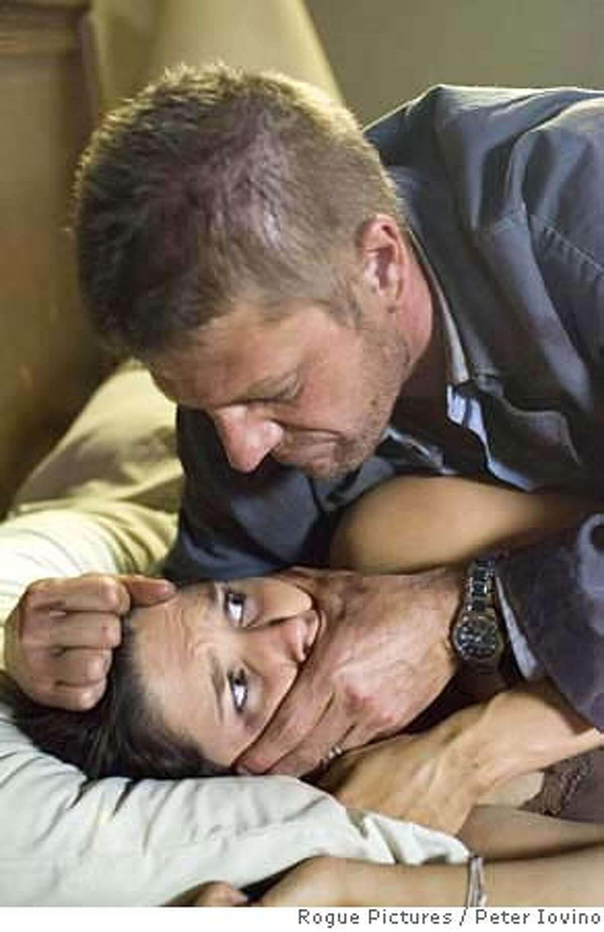 In this photo provided by Rogue Pictures, Sean Bean (top) and Sophia Bush (bottom) star in