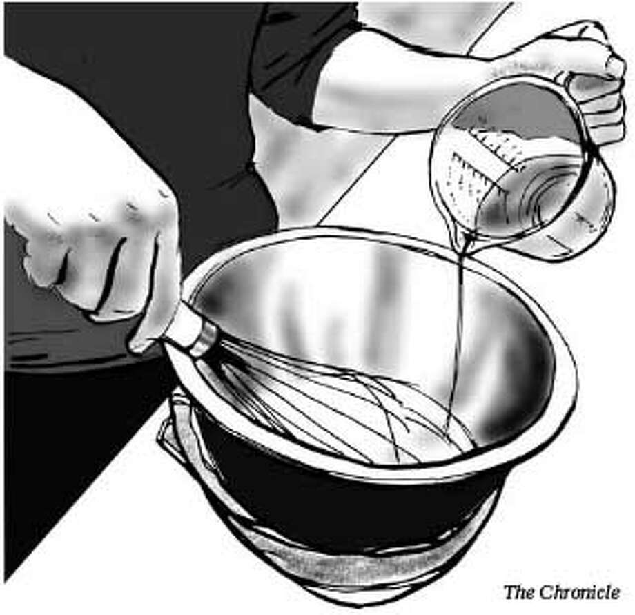 Slowly whisking in the oil is one of the most important steps in making mayonnaise. Chronicle Illustration
