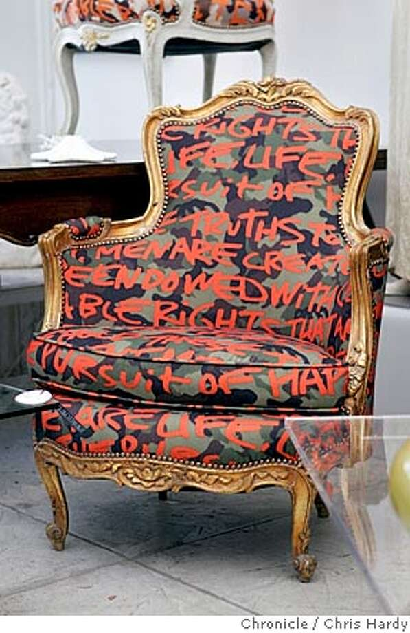 Sheri Sheridan of Swallowtail Interiors has reproduction furniture from the 1900-1920 period.  1930s Louis XV chair with striped upholstery Stephen Sprouse with grafitti/ camoflague upholstery  in San Francisco  6/21/05 Chris Hardy / San Francisco Chronicle Photo: Chris Hardy