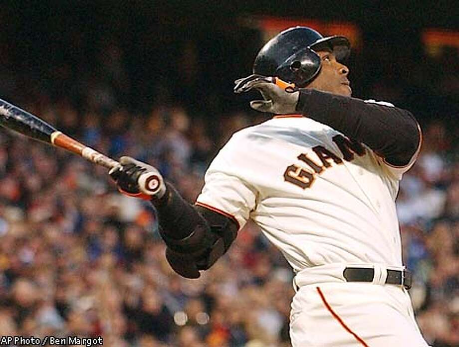 San Francisco Giants Barry Bonds watches his home run off Los Angeles Dodgers' Odalis Perez during the second inning Friday, April 11, 2003, in San Francisco. (AP Photo/Ben Margot) Photo: BEN MARGOT