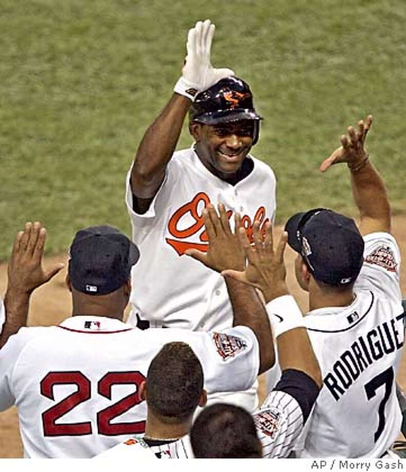 American League All-Star Miguel Tejada of the Baltimore Orioles is congratulated by Ivan Rodriguez (7) of the Detroit Tigers and Boston Red Sox hitting coach Ron Jackson (22) after his second inning home run off National League All-Star pitcher John Smoltz of the Atlanta Braves in the 2005 MLB , at Comerica Park in Detroit, Tuesday, July 12, 2005. (AP Photo/Morry Gash) Photo: MORRY GASH