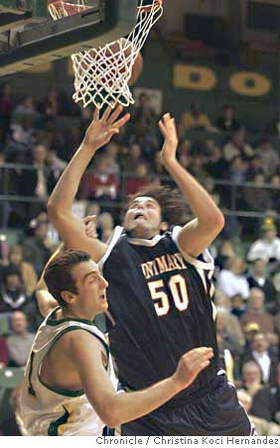 St.Mary's #50, Omar Samhan shoots over USF's #41, Danny Cavic.At USF, St. Mary's defeats USF in overtime. USF Men's basketball team hosts St. Mary's at Memorial Gymnasium on USF campus.(CHRISTINA KOCI HERNANDEZ/CHRONICLE)  Ran on: 01-21-2007  Omar Samhan (50) scored a team-high 19 points against Danny Cavic and USF. The Gaels' center also had a career-high 10 rebounds.  Ran on: 01-21-2007  Omar Samhan (50) scored a team-high 19 points against Danny Cavic and USF. The Gaels' center also had a career-high 10 rebounds. Photo: CHRISTINA KOCI HERNANEZ/CHRONICL