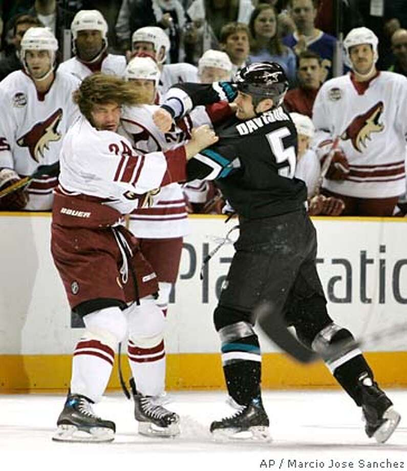 San Jose Sharks defenseman Rob Davison, right, fights with the Phoenix Coyotes' Josh Gratton in the first period of an NHL hockey game in San Jose, Calif., Thursday, Jan. 18, 2007.(AP Photo/Marcio Jose Sanchez) Photo: Marcio Jose Sanchez
