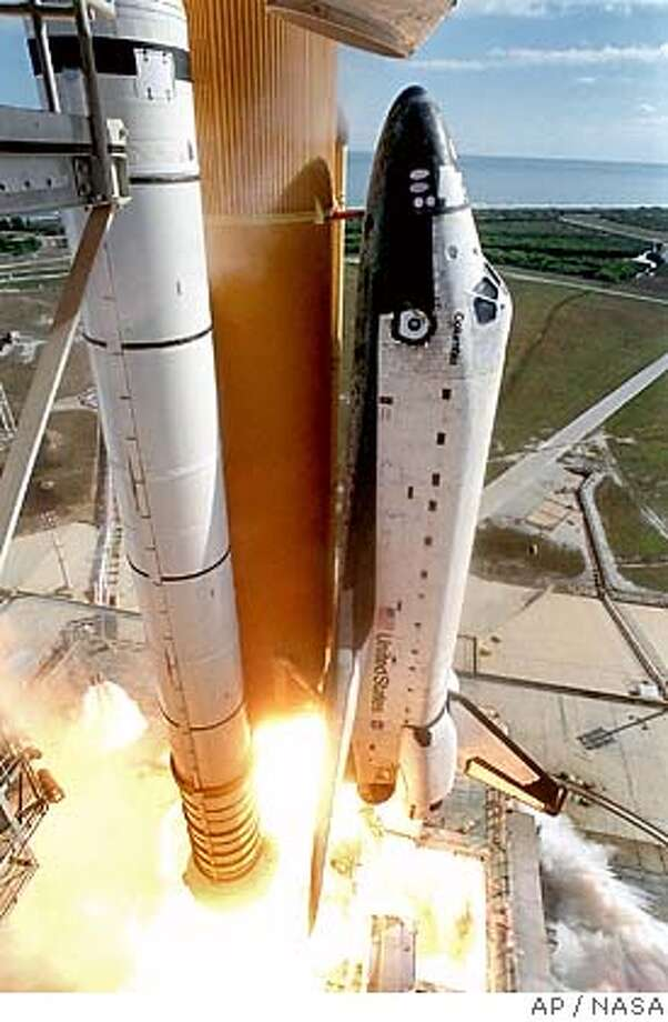 **FILE** In this photo released by NASA, the Columbia lifts off Jan. 16, 2003 from Kennedy Space Center in Cape Canaveral, Fla. Seven astronauts were killed when the orbiter broke apart during reentry Feb. 1, 2003. NASA plans to return to space on Wednesday, July 13, 2005 with the Discovery is scheduled to lift off on a 12-day mission. (AP Photo/NASA)