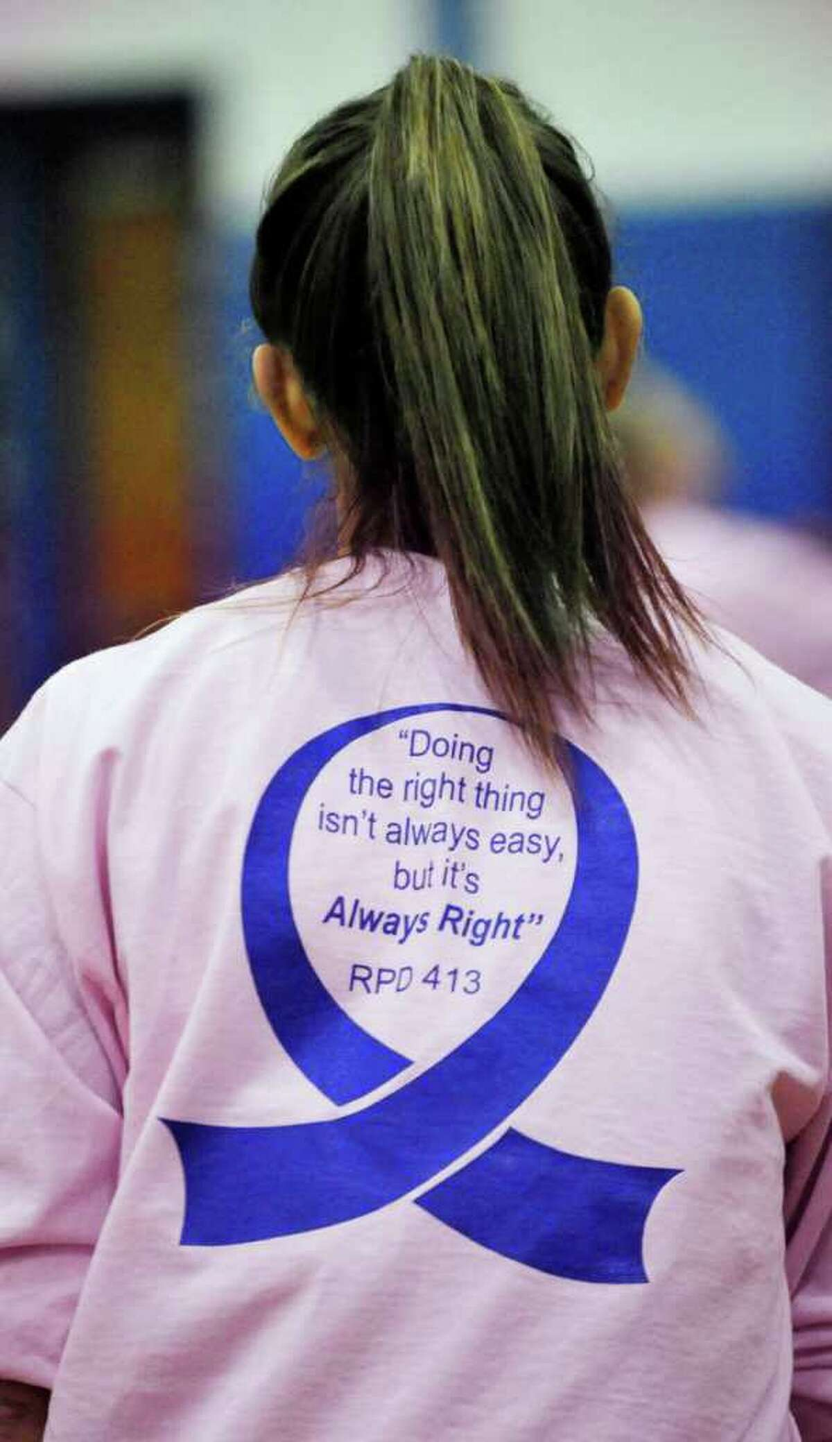 During warm-ups before their fourth annual Pink Game against Ridgefield, Danbury girls basketball players sported a memorial T-shirt with a quote from Danbury's former coach Bobby DiNardo at Danbury High School on Friday, Jan. 20, 2012. The Pink Game is played to create awareness for cancer and to remember former coach and Danbury Police Officer Bobby DiNardo who died from cancer.