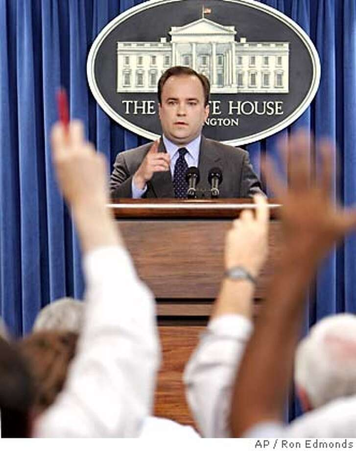 White House Press Secretary Scott McClellan is peppered by questions about deputy White House chief of staff Karl Rove, Monday, July 11, 2005, during his daily briefing at the White House. Rove's name resurfaced in the past week, with his lawyer saying that Time magazine reporter Matthew Cooper spoke to him in the days before the name of CIA undercover operative Valerie Plame was first revealed. McClellan would not answer questions about Rove due to the on going investigation. (AP Photo/Ron Edmonds) Photo: RON EDMONDS
