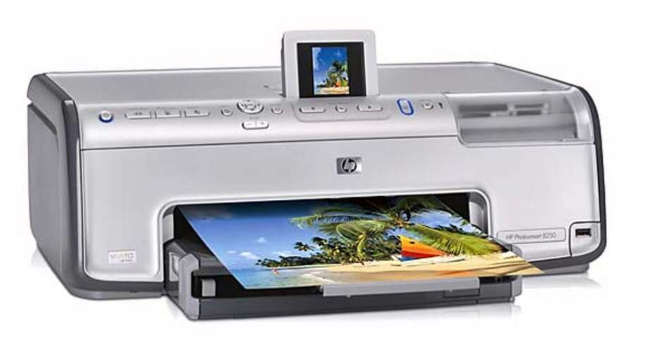 This undated photo supplied by Hewlett-Packard Co. shows their new HP Photosmart 8250 printer. HP says it is the first inkjet printer with a printing head made with new technology that cuts photo printing time in half. It will be a $199 machine that can print a 4-by-6-inch photo in 14 seconds.(AP Photo/Hewlett-Packard Co.)