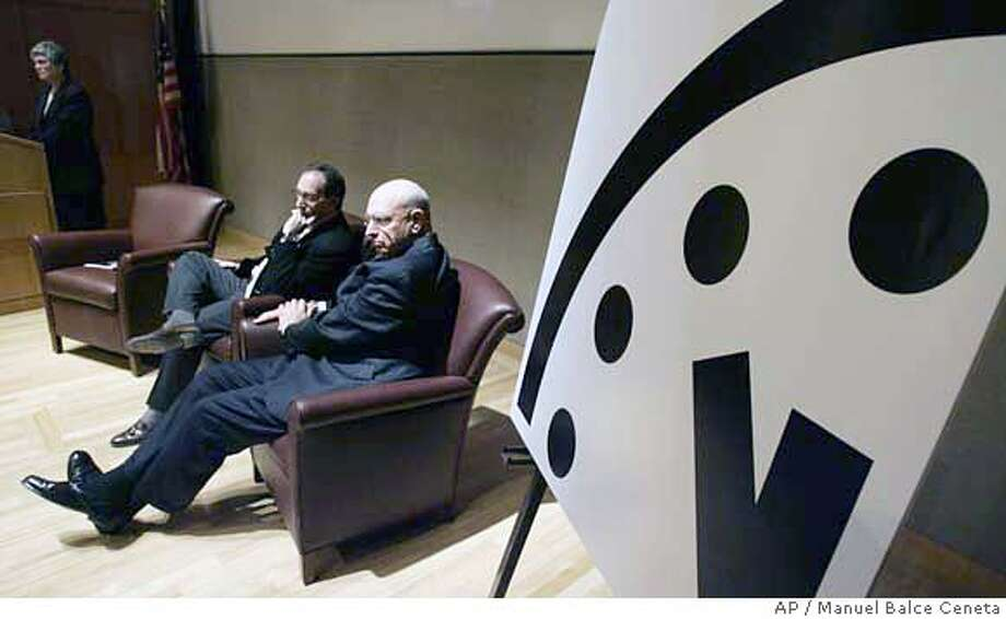 """Kennette Benedict, back left, executive director of Bulletin of the Atomic Scientist, Lawrence Krauss, center, and Ambassador Thomas Pickering, right, attend the unveiling of the """"Doomsday Clock"""" during a news conference in Washington, Wednesday, Jan. 17, 2007. The Doomsday Clock, created in 1947, reflects the global failures to solve the problems posed by nuclear weapons and the climate crisis. The clock has been adjusted only 17 times prior to today. (AP Photo/Manuel Balce Ceneta) Photo: MANUEL BALCE CENETA"""