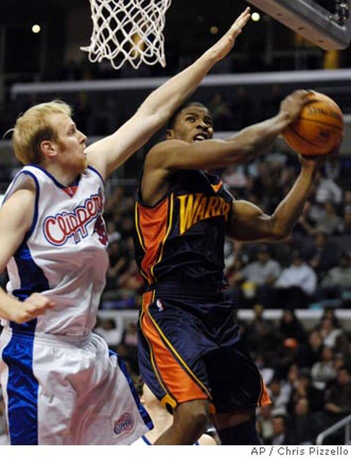 Golden State Warriors' Kelenna Azubuike, right, is fouled by Los Angeles Clippers' Chris Kaman during the first half of an NBA basketball game in Los Angeles, Wednesday, Jan. 17, 2007. (AP Photo/Chris Pizzello) Photo: Chris Pizzello