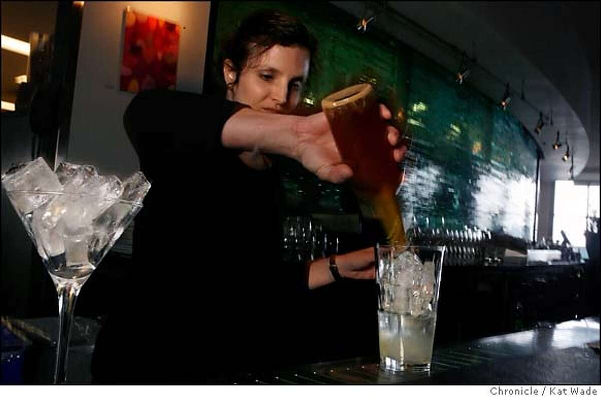 BITTERS12_0068_KW_.jpg Slanted Door bartender Jennifer Colliau who makes her own bitters; distilled herbs, roots, barks and plants mixes a Rye Manhattan with warm spice bitters that will soon be added to the menu at the Slanted Door on the Embarcadero in San Francisco on January 2, 2007 for the photographer. Kat Wade/The Chronicle Mandatory Credit for San Francisco Chronicle and photographer, Kat Wade, Mags out