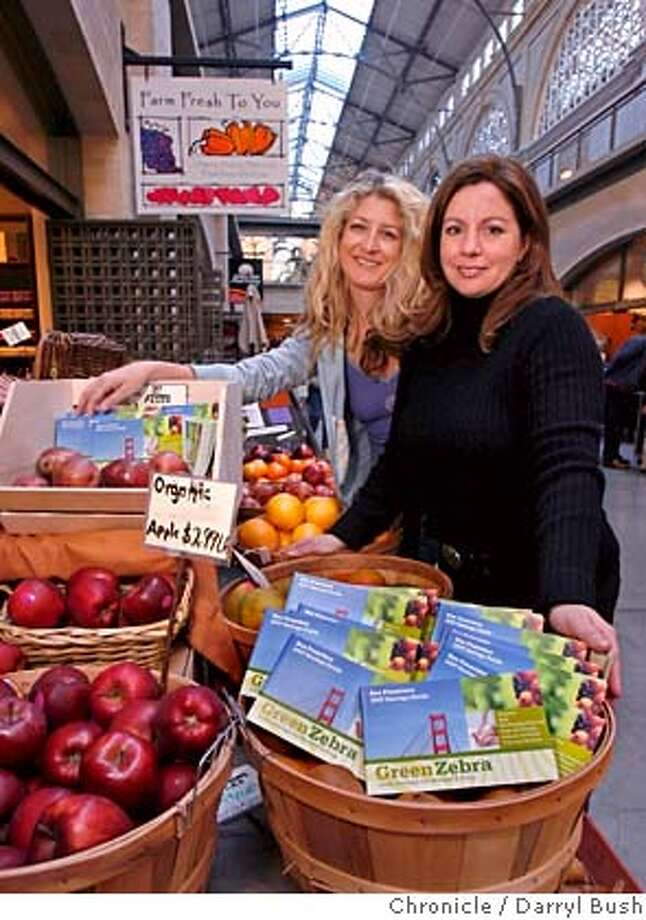 "zebra_0001_db.JPG  Anne Vollen, left, and Sheryl Cohen, founders of Green Zebra, stand next to produce and their ""Green Zebra coupon books,"" at the store, ""Farm Fresh To You,"" inside the Ferry Building in San Francisco, CA, on Thursday, January, 18, 2007. photo taken: 1/18/07  Darryl Bush / The Chronicle ** Anne Vollen, Sheryl Cohen (cq) MANDATORY CREDIT FOR PHOTOG AND SF CHRONICLE/ -MAGS OUT Photo: Darryl Bush"