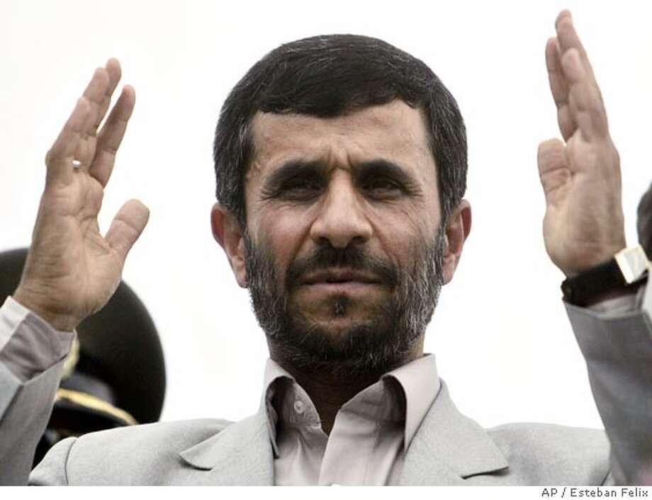 Iran'S President Mahmoud Ahmadinejad gestures during a visit to the 'Cuba Libre' neighborhood in Managua, Sunday, Jan. 14, 2007. (AP Photo/Esteban Felix) Photo: Esteban Felix