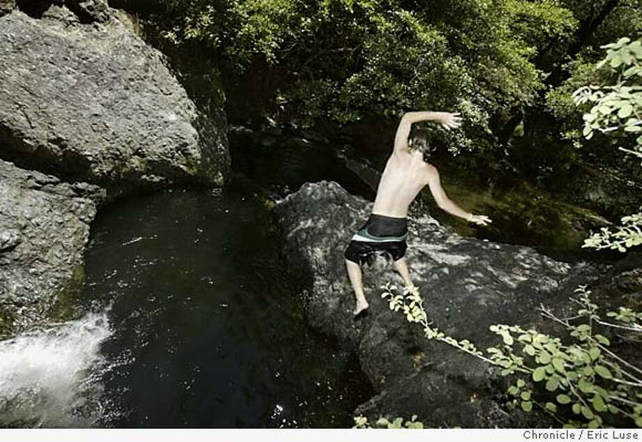 weather_025_el.JPG  Cameron Reid,17, San Anselmo escapes the heat as he goes for swimming hole plunge in the Paper Mill Creek near Samuel P. Taylor State Park in Marin County. Event on 7/11/05 in Marin County Eric Luse / The Chronicle MANDATORY CREDIT FOR PHOTOG AND SF CHRONICLE/ -MAGS OUT Photo: Eric Luse