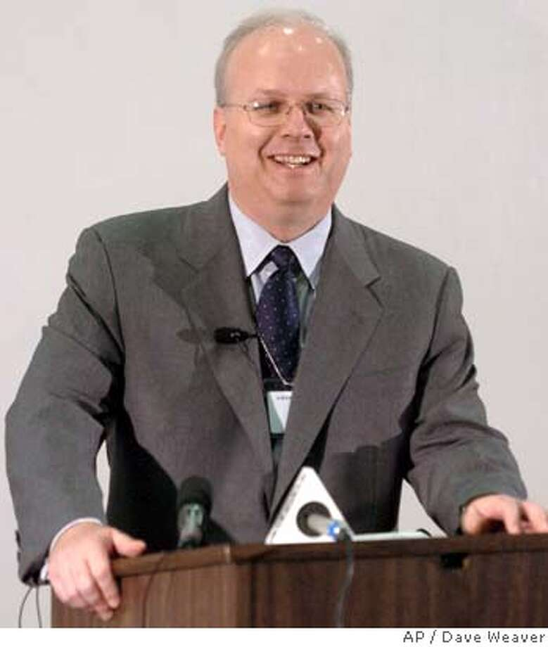 White House Chief of Staff Karl Rove addresses employees Friday July 8, 2005, at Ameritrade's Bellevue, Neb, office. Rove is in Nebraska for a fundraiser in Omaha. (AP Photo/Dave Weaver) Photo: DAVE WEAVER