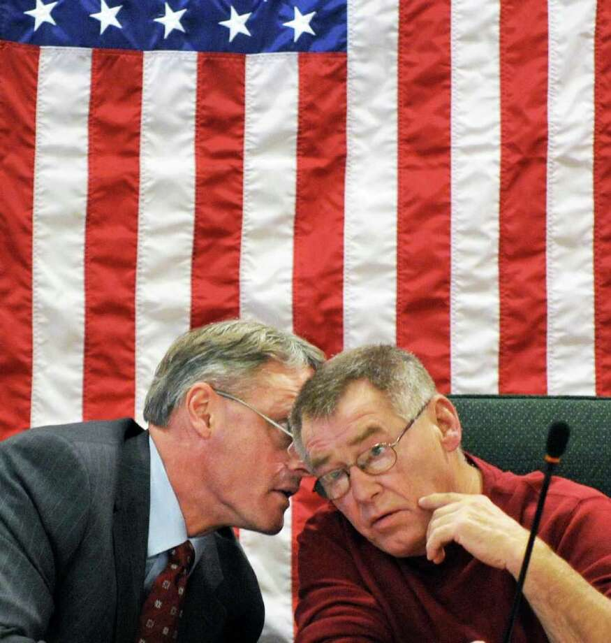 Saratoga County Administrator Spencer Hellwig, left, and Miltom Supervisor and chairman of the law and finance committee, Frank Thompson confer during the Saratoga Board of Supervisors' budget workshop session in Ballston Spa Friday Nov. 18, 2011.   (John Carl D'Annibale / Times Union) Photo: John Carl D'Annibale / 00015469A