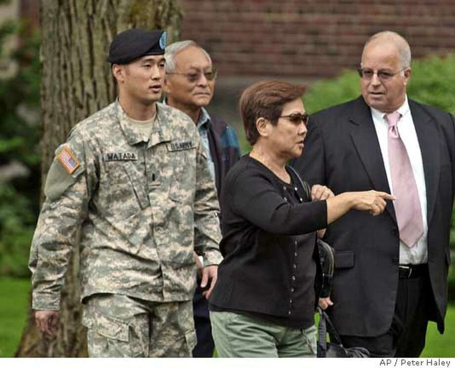 ** CORRECTS NAME OF WOMAN AND RELATIONSHIP ** Army Lt. Ehren Watada, left, walks with father, Bob Watada; his stepmother, Rosa Sakanishi; and attorney, Eric Seitz, during a lunch break in an Army hearing concerning Watada's refusal to deploy to Iraq, at Fort Lewis, Wash., Thursday, Aug. 17, 2006. Watada, 28, of Honolulu, was charged last month with conduct unbecoming an officer, missing troop movement and contempt toward officials. He refused to deploy to Iraq on June 22 with his Stryker unit, the 3rd Brigade, 2nd Infantry Division based at Fort Lewis. (AP Photo/The News Tribune, Peter Haley) Photo: PETER HALEY