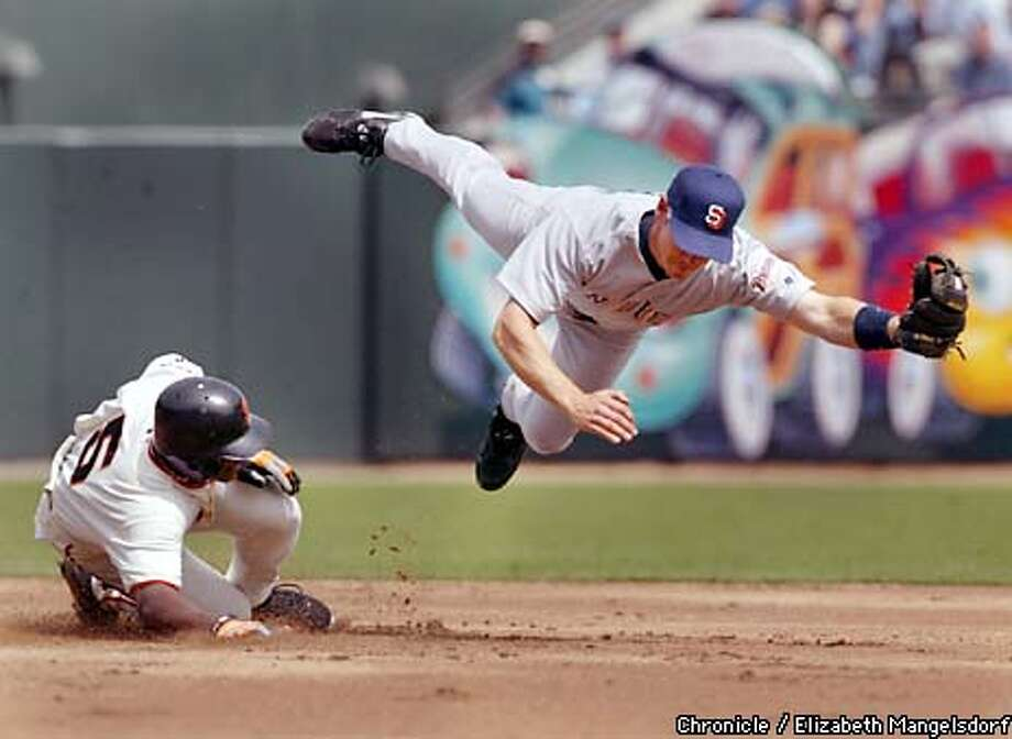 Ray Durham slides safely into 2nd base as San Diego's Mark Loretta is pulled off the bag by a bad throw. This was part of the Giants 7 run 1st inning. Photo by Liz Mangelsdorf Photo: Liz Mangelsdorf