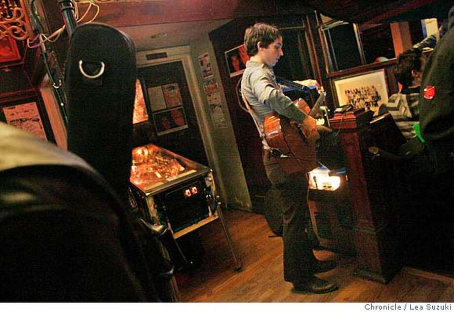 "soundscene_155_ls.jpg  ""Fancy Dan"" (real name Dan Nordheim) takes out his guitar and tunes up at Open Mic night at The Hotel Utah.  Open Mic at the Hotel Utah located at 500 4th Street on Monday, January 15, 2007. Photo by Lea Suzuki/The San Francisco Chronicle  Photo taken on 1/15/07, in San Francisco, CA. **(themselves) cq. MANDATORY CREDIT FOR PHOTOG AND SAN FRANCISCO CHRONICLE/ -MAGS OUT Photo: Lea Suzuki"