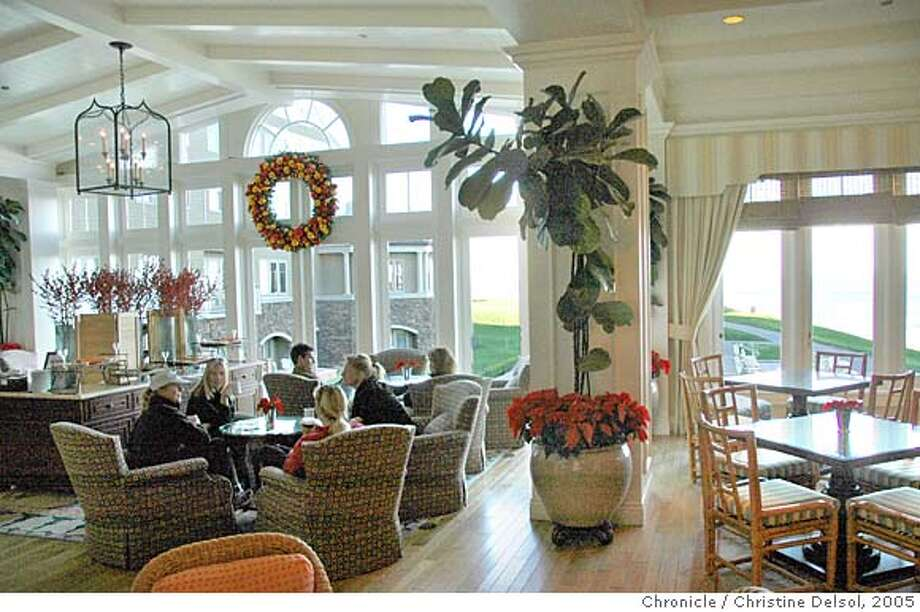TRAVEL HALF MOON BAY, Calif. -- The Conservatory lounge and eating area of the Ritz Carlton- Half Moon Bay .  Christine Delsol/The Chronicle Ran on: 01-29-2006  Commanding an ocean bluff on the San Mateo coast, the Ritz-Carlton is no longer a local dot-com millionaires' playground but a seaside resort for worldwide Ritz devotees who &quo;simply expect more.&quo; Photo: Christine Delsol