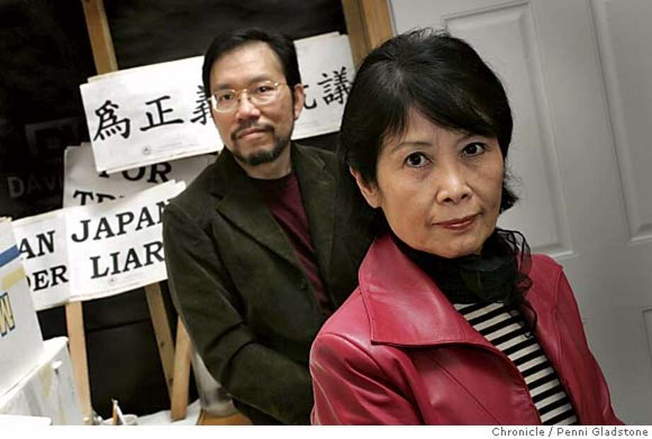 "japanredress11_0015_PG.JPG Protest signs behind them. the one in Chinese behind them says, ""For justice and protest."" Philip at left and Poland.  Local chinese americans are at the forefront of publicizing the Japanese wartime atrocities. The Chinese Holocaust musume in the Sunset District of SF is one example.President Poland Hung and executive director Philip Ng will be at the museum  The San Francisco Chronicle, Penni Gladstone  Photo taken on 7/10/05, in Los Altos, Photo: Penni Gladstone"