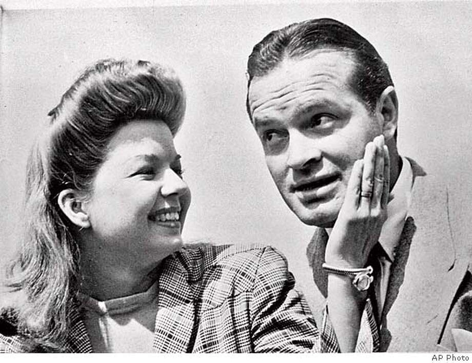 """**FILE**Singer-actress Frances Langford gives comedian Bob Hope a pat on the cheek, as they visit U.S. Army headquarters in London on June 26, 1943. Hope was leading a tour, which included Langford, to entertain U.S.troops in the European theater during World War II. Langford, whose steamy rendition of """"I'm in the Mood for Love"""" captivated soldiers when she was part of Bob Hope's USO tours during World War II, died Monday, July 11, 2005, at the age of 92. Langford had been ill with congestive heart failure and died at her home in Jensen Beach, Fla., said her lawyer, Evans Crary Jr. (AP Photo) A JUNE 26 1943 B&EW FILE PHOTO"""