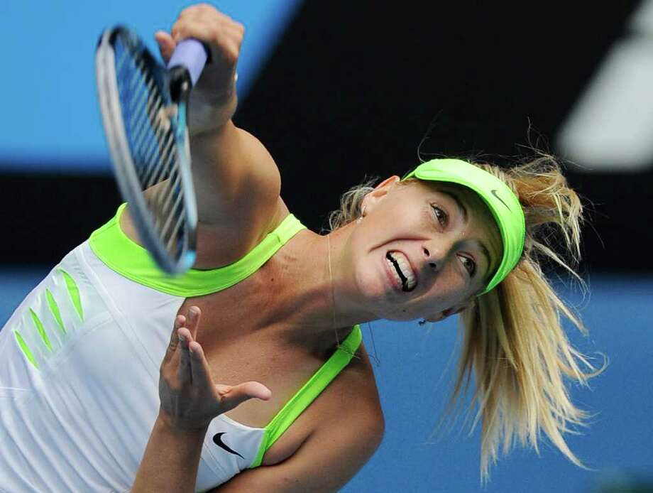 Russia's Maria Sharapova serves to Germany's Angelique Kerber during their third round match, which Sharapova won 6-1, 6-2. Photo: AP
