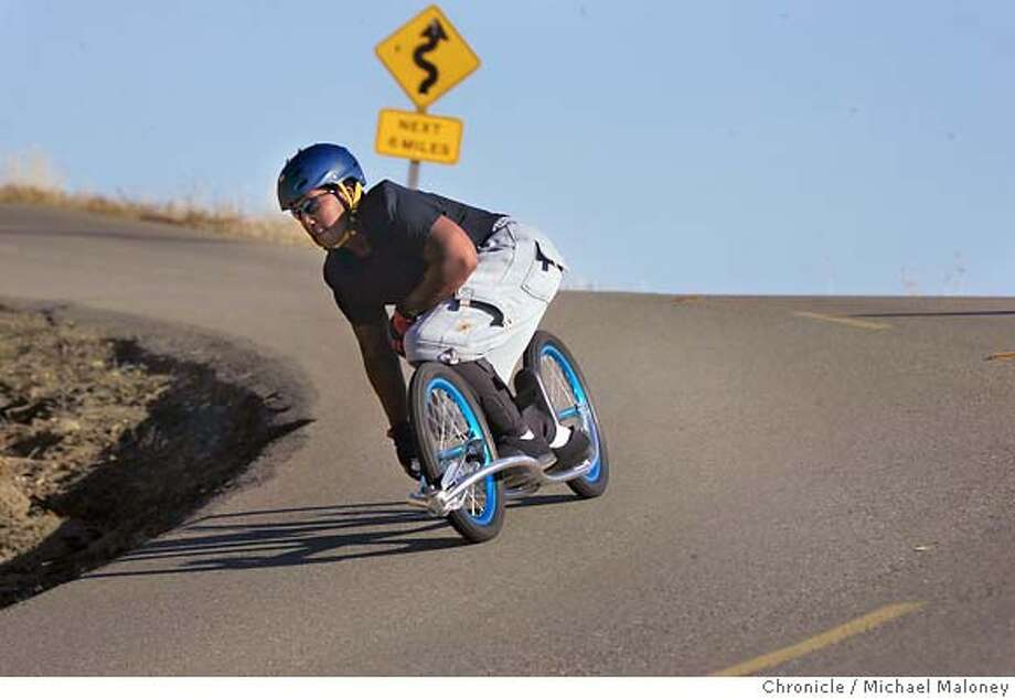 Kyle Middlebrooks of Vallejo loves to go fast - the faster the better. That's why 3 years ago, he took up dirtsurfing. The sport originated in Australia and is starting to catch on here in the US. It involves keeping balance on a oversized aluminum skateboard but with only two oversize wheels and a brake. Middlebrooks likes to surf the downhill roads of Mt Diablo State Park, often reaching speeds well over 40mph - way over the posted speed limit. Besides, he's breaking the law just surfing on the mountain since all gravity propelled modes of transportation are outlawed.  Photo by Michael Maloney / San Francisco Chronicle Photo: Michael Maloney