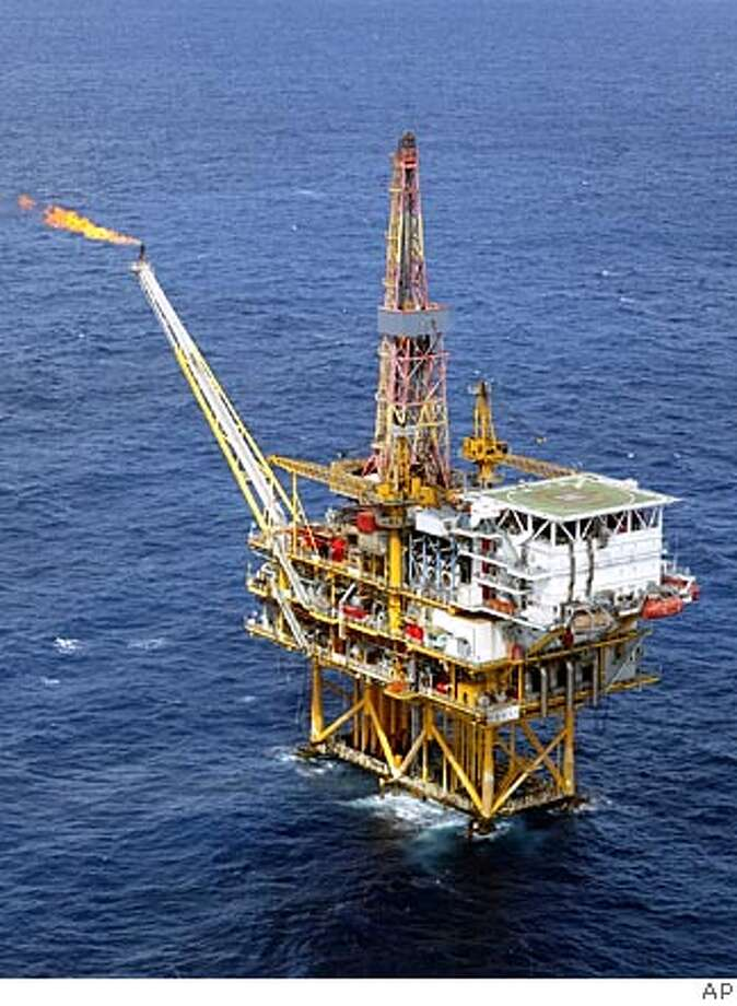 ** FILE ** The offshore platform of the Pinghu Oil and Gas Field, part of China National Offshore Oil Corporation (CNOOC) Ltd. facilities is seen in this Sept 23, 2003 file photo, in eastern China Sea near Shanghai. China's third-largest oil producer made an unsolicited US$18.5 billion (euro15.3 billion) bid Thursday, June 23, 2005 for U.S. oil and gas company Unocal Corp., setting up a possible contest with rival bidder Chevron Corp. (AP Photo) ** ONLINE OUT, CHINA OUT ** ONLINE OUT, CHINA OUT, HOLD FOR USE WITH STORY BEIJING'S OIL MAN BY JOE MCDONALD, A SEPT 23, 2003 FILE PHOTO
