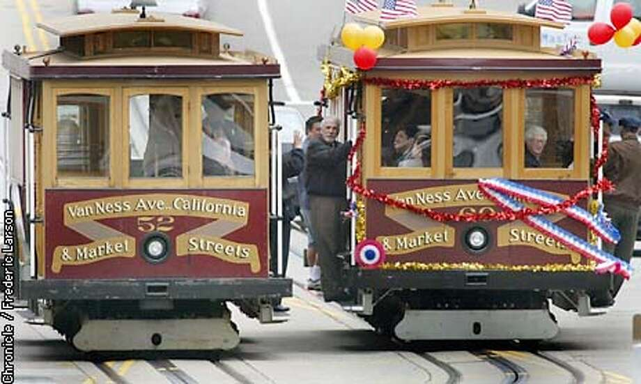 CABLECAR3-C-10APR03-MT-FRL: San Francisco Municipal Railway celebrated their 125th anniversary by releasing a new Cable Car that will travel and service customers on California Street. Chronicle photo by Frederic Larson Photo: FREDERIC LARSON