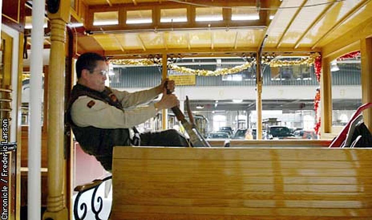 CABLECAR2-C-10APR03-MT-FRL: Juan Vigil (gripman) test out the new equipment before taking the new Cablecar out on it's maiden voyage. San Francisco Municipal Railway celebrated their 125th anniversary by releasing a new Cable Car that will travel and service customers on California Street. Chronicle photo by Frederic Larson