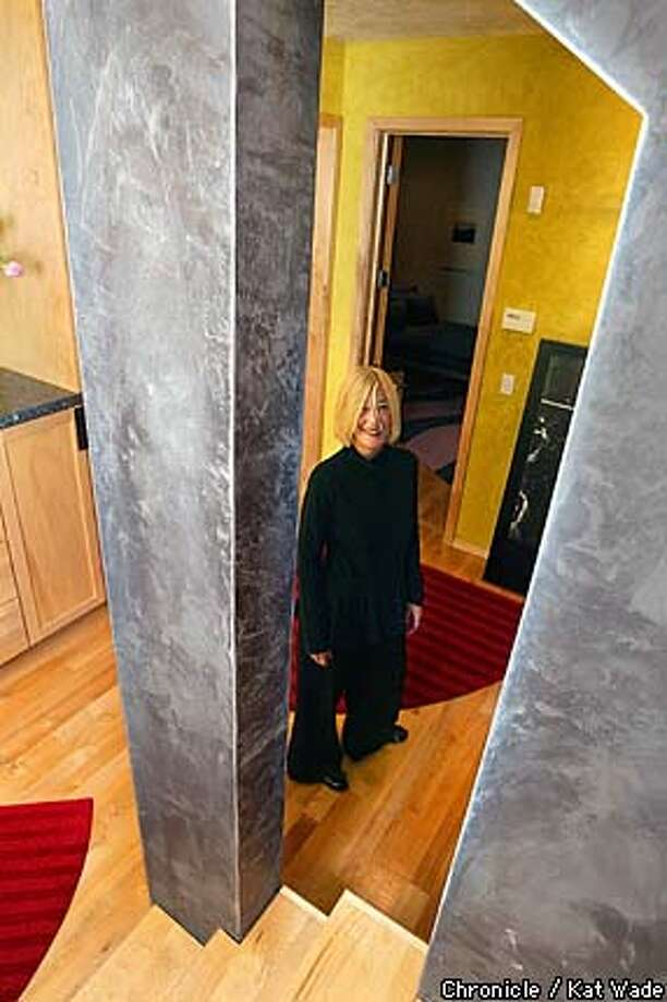 Carpet designer, Hansine Goran, can be seen through a fun dramatic arch in the downstairs of her contemporary Oakland hills home March 26, 2003. SAN FRANCISCO CHRONICLE PHOTO BY KAT WADE Photo: KAT WADE