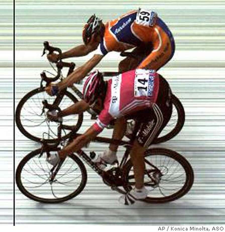 In this photo-finish released Saturday by Konica Minolta and ASO, Amaury Sport Organization, the race's organizer, Pieter Weening of The Netherlands, rear, crosses the finish line ahead of Andreas Kloden of Germany to win the 8th stage of the Tour de France cycling race between Pforzheim, Germany, and Gerardmer, eastern France, Saturday, July 9, 2005. (AP Photo/Konica Minolta/ASO)