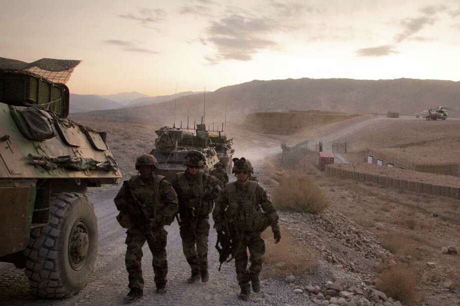 French soldiers from the 1st Infantry Regiment return to the Nijrab military base in Tora, in the Surobi province in Afghanistan. On Friday, four French troops were shot dead by a man dressed as an Afghan soldier in eastern Afghanistan. Photo: JOEL SAGET / AFP ImageForum