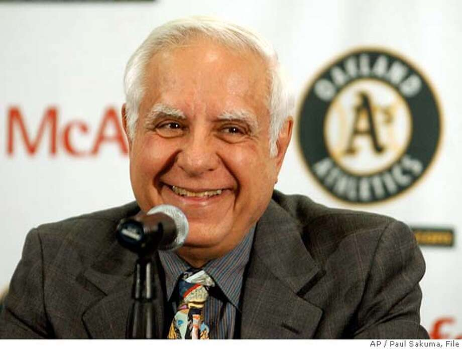 ** FILE **Oakland Athletics co-owner Lew Wolff smiles during a news conference in Oakland, Calif., Friday, April 1, 2005. The Oakland A's owners struck a deal with Major League Soccer to bring a team back to the San Francisco Bay area after the San Jose Earthquakes left for Houston over a stadium squabble, officials said Wednesday, May 24, 2006. Lew Wolff and John Fisher, the A's principal owners, will have three years to buy a team and develop a stadium solely for soccer. The location of the new stadium has not been determined but the new Earthquakes office will be located in downtown San Jose. (AP Photo/Paul Sakuma)  Ran on: 05-25-2006  Lew Wolff: &quo;I guess we are in the venue business these days with baseball and soccer.&quo;  Ran on: 05-25-2006  Lew Wolff: &quo;I guess we are in the venue business these days with baseball and soccer.&quo;  ALSO Ran on: 11-09-2006  Lew Wolff offered few details to city officials on Wednesday regarding the stadium plan. APRIL 1 2005 EFE OUT Photo: PAUL SAKUMA
