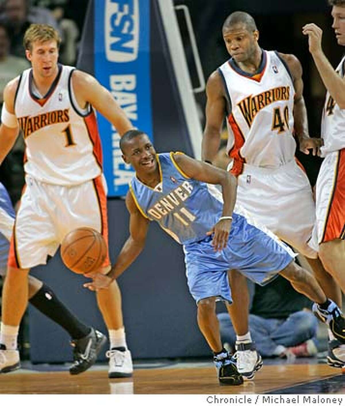 Five foot five Earl Boykins of Denver looks for someone to pass to as Warriors #1 Troy Murphy, #40 Calbert Cheaney and 34 Mike Dunleavy look on in the 2nd period. Golden State Warriors vs Denver Nuggets at The Arena in Oakland. Event in Oakland, CA Photo by Michael Maloney / The Chronicle