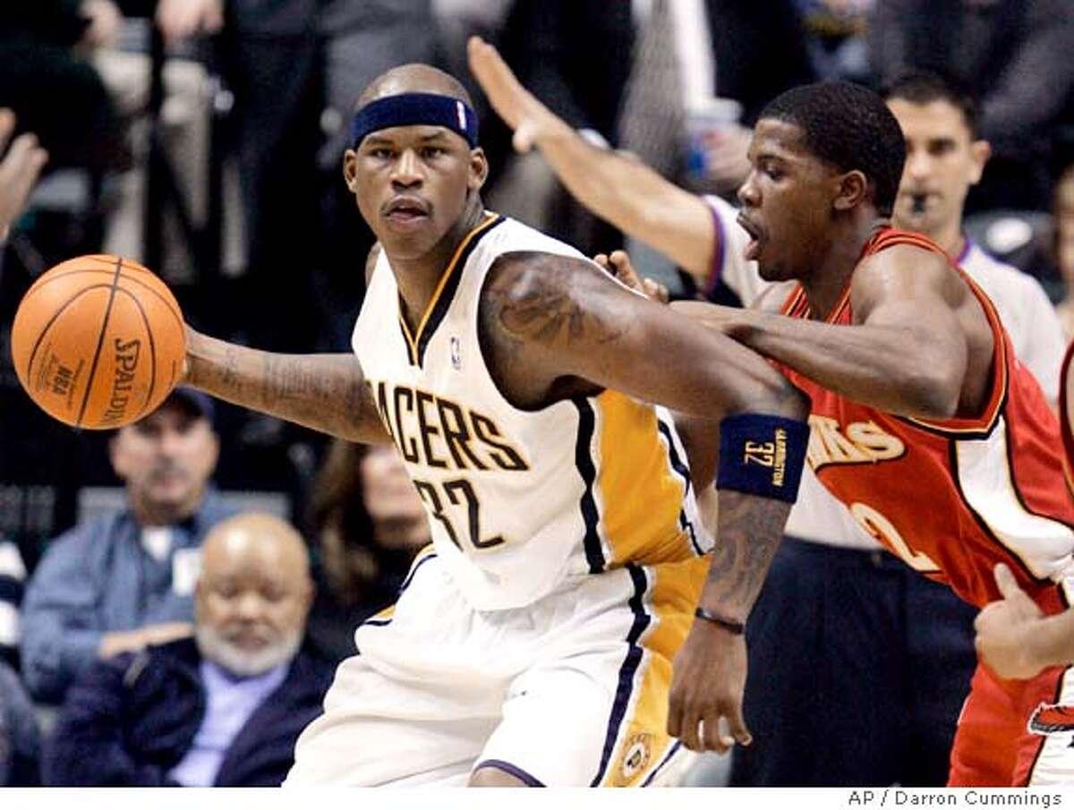 Indiana Pacers forward Al Harrington, left, is defended by Atlanta Hawks' Joe Johnson during the third quarter of an NBA basketball game in Indianapolis, Tuesday, Jan., 9, 2007. Indiana won 91-72. (AP Photo/Darron Cummings)