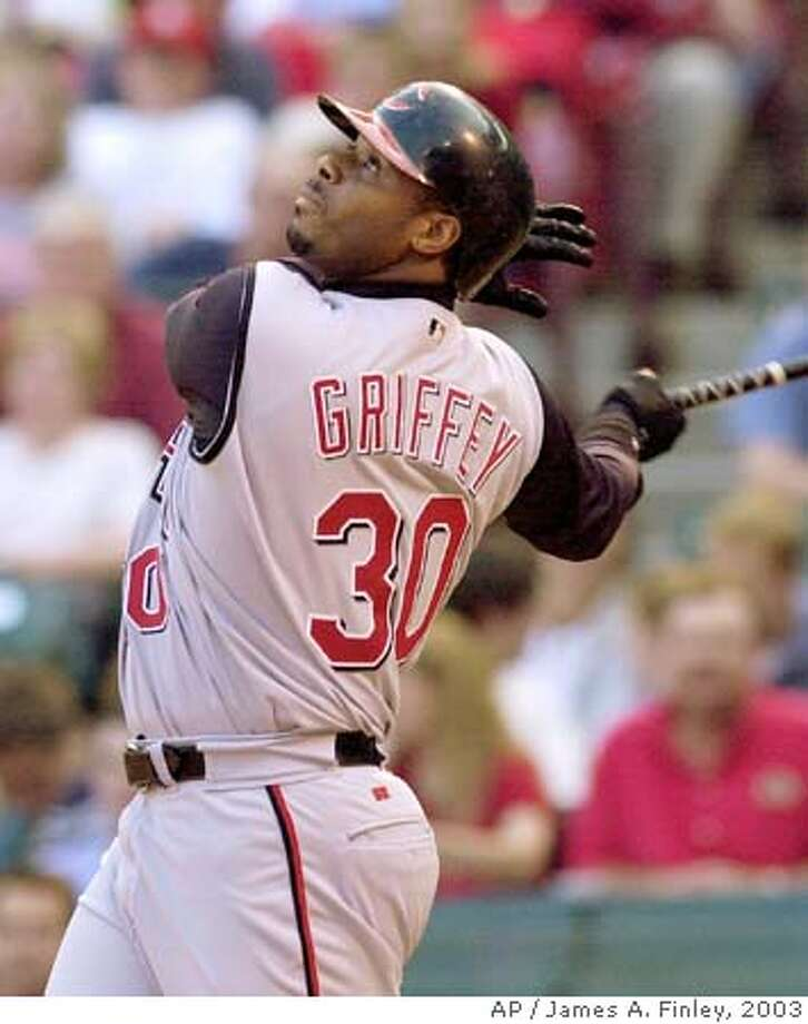 Cincinnati Reds' Ken Griffey Jr. watches as he pops up to St. Louis Cardinals shortstop Edgar Renteria while at bat during the first inning Wednesday, May 14, 2003 in St. Louis. Griffey was making his first start after being reinstated from the disable list with a dislocated shoulder suffered on April 5, 2003 against Chicago. (AP Photo/James A. Finley) ProductNameChronicle ProductNameChronicle ProductNameChronicle Ran on: 02-06-2005  Ken Griffey Jr. is reporting with pitchers and catchers this month to get a jump on his 2005 season. Photo: JAMES A. FINLEY